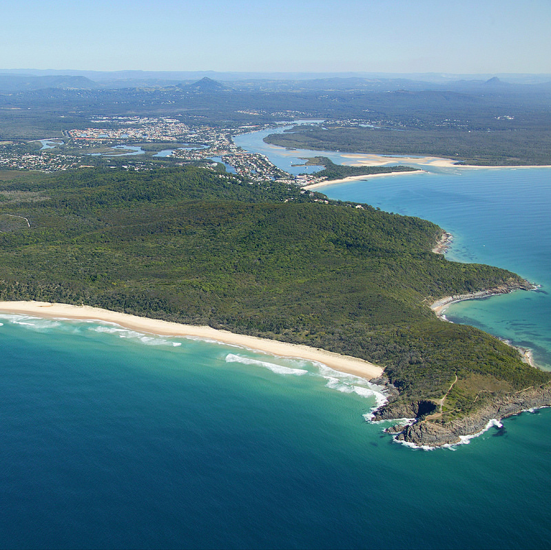 An aerial view of Noosa heads with the Noosa national park in the foreground