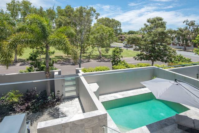 A deluxe holiday home with a beautiful pool and views
