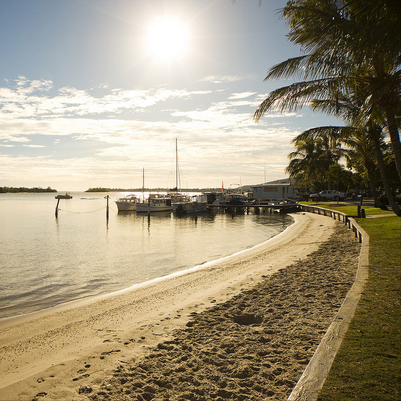 Boats docked on the Noosa river where there is plenty of Noosa accommodation options