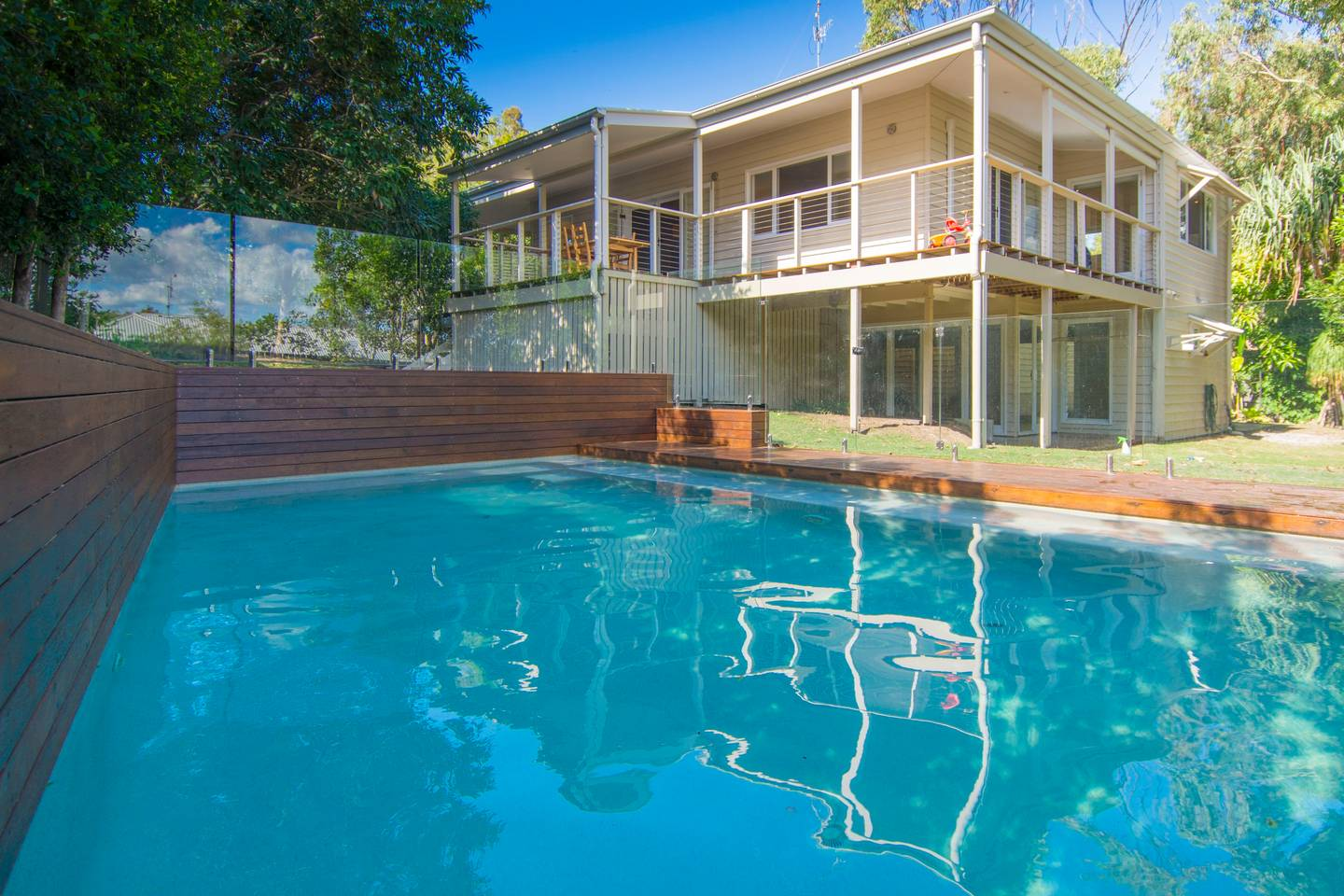 A large swimming pool in the yard of a property in Sunrise Beach